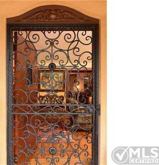 Security Screen Door On California Spanish Revival Bungalow Home Remodeling Security Screen Door Home Decor