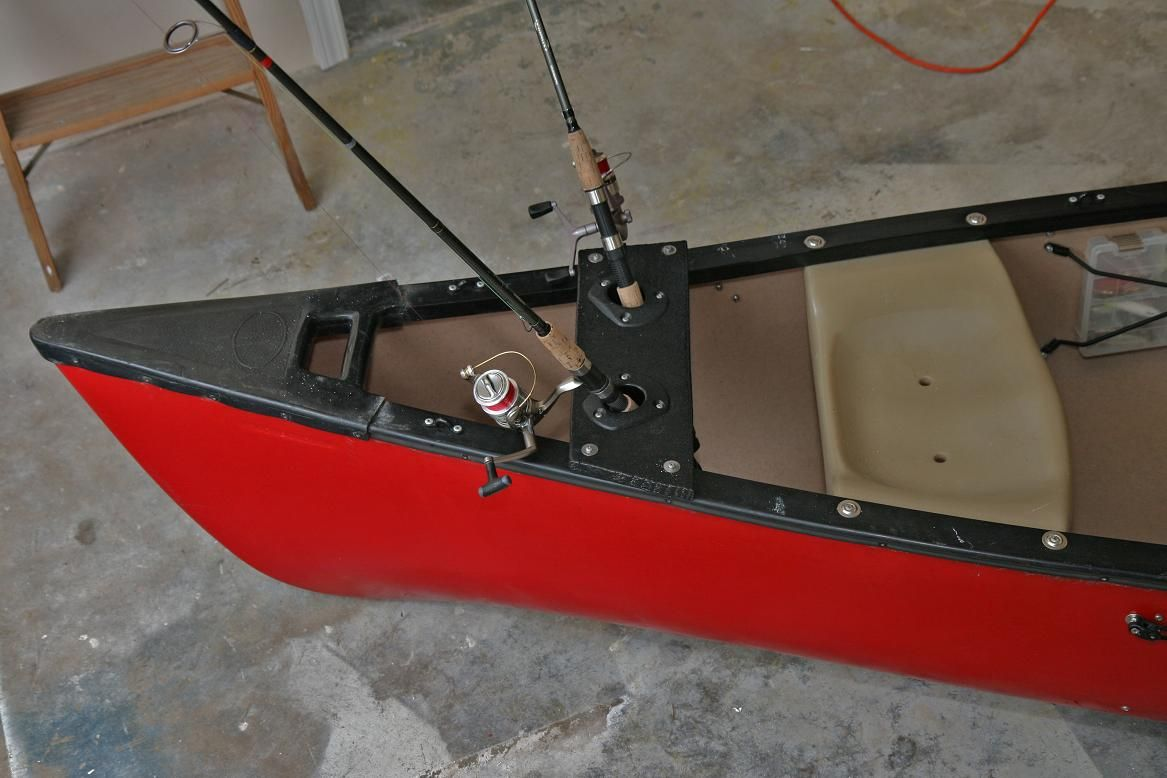 This canoe is rigged with yak gear two yak gear flush for Kayak fishing pole holder