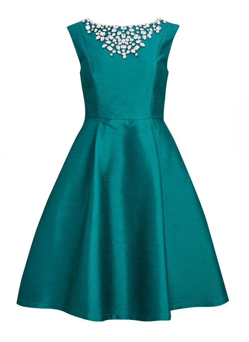 A sleeveless party dress in teal green with a glittering jewel ...