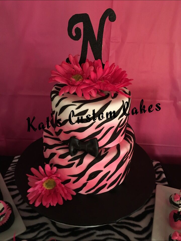 hot pink and zebra stripe cake with hot pink flowers and letter n topper