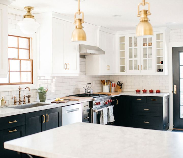 Black And White Cabinets With White Carrara Marble Countertops And