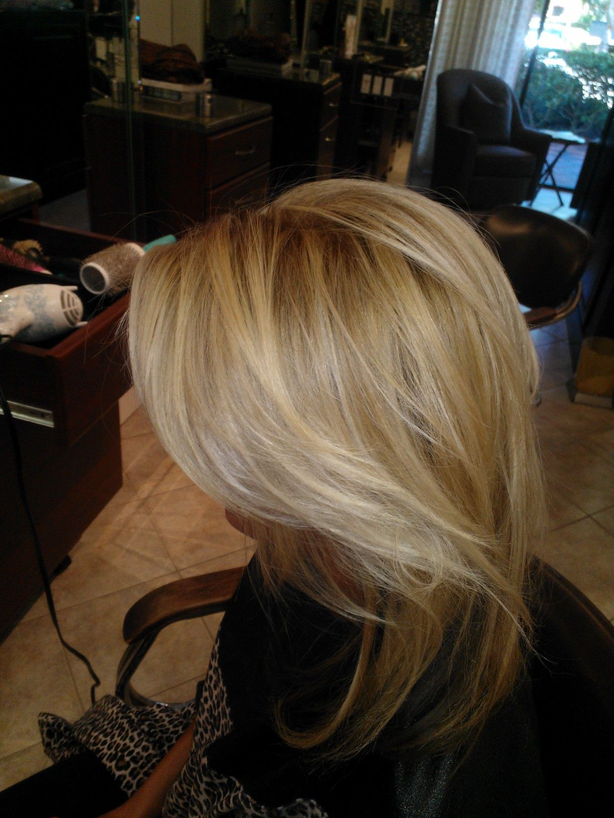Beautiful dimensional blond with a slightly darker root is so modern