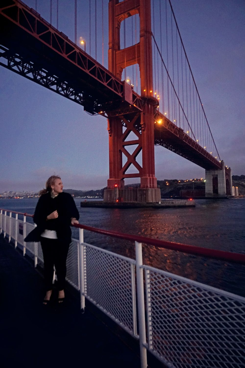 Sunset Cruise in San Francisco. Bundle up in sweaters while on a boat in the…