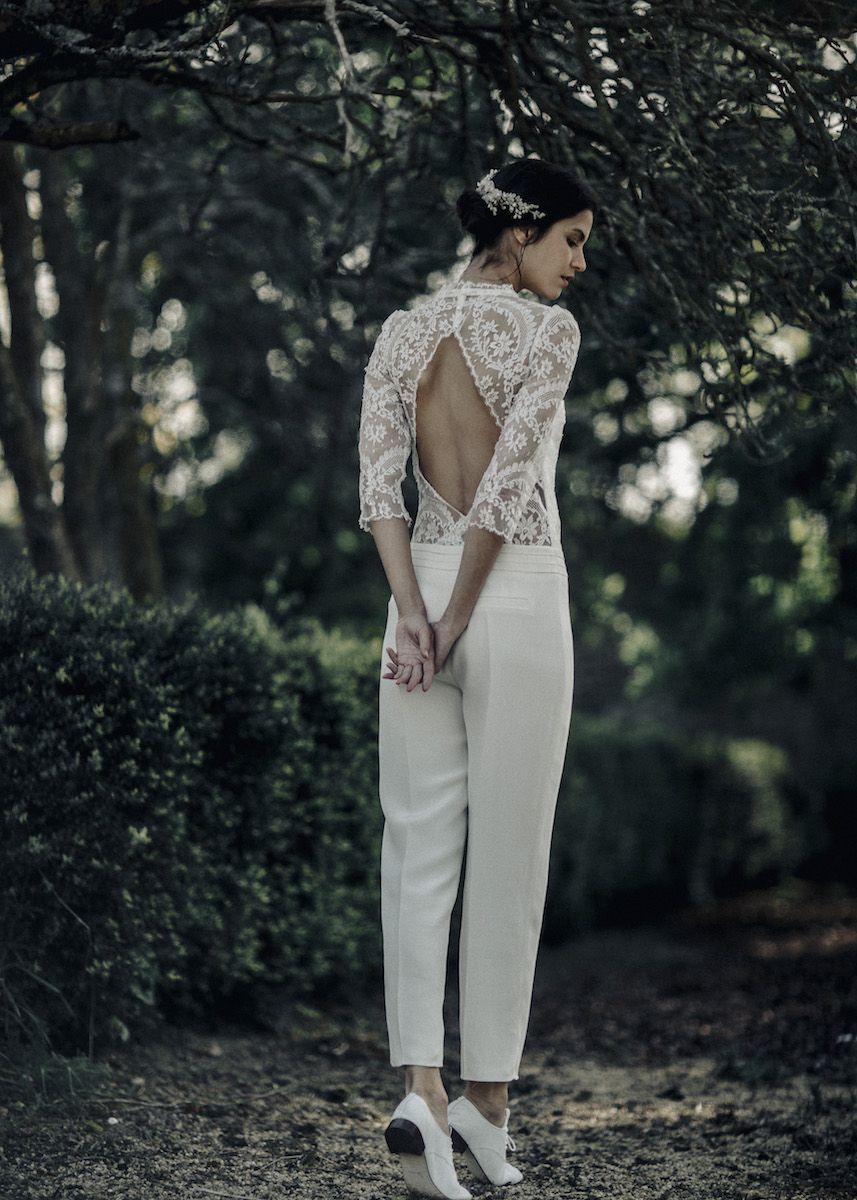 ae9522716a8 We love this feminine pantsuit with lace detailing and an open-back