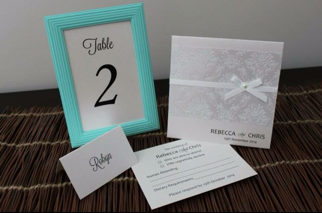 Gorgeous Ivory Wedding Invitation Set including matching RSVP postcard, place card & framed table number.   Visit http://facebook.com/moderndesigns1 to see more products in my albums