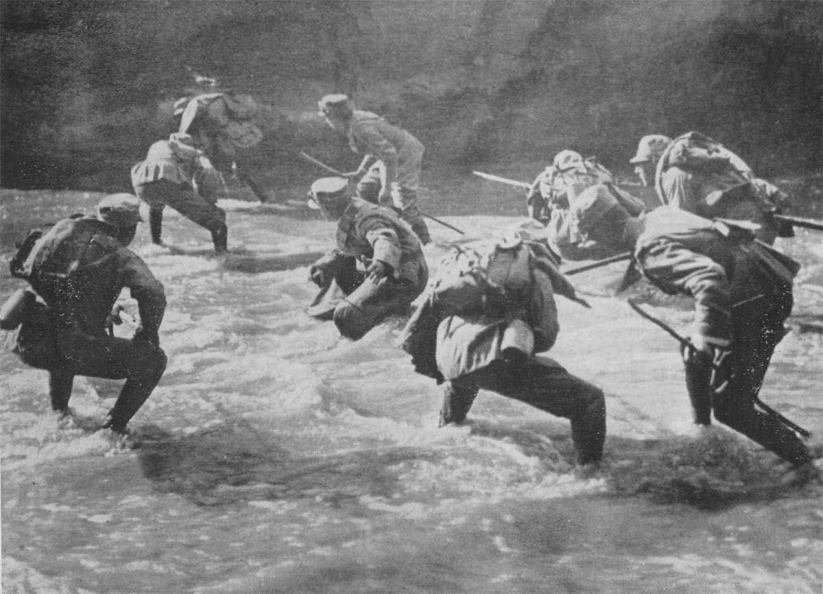 002 Italian troops crossing a stream under enemy fire during