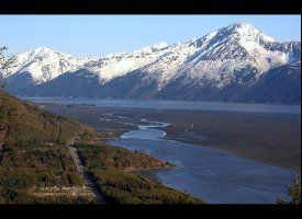 Seward Highway, Alaska -- The 127-mile Seward Highway links Anchorage to Seward on magnificent Resurrection Bay. This land incluces boreal forests, mammoth glaciers, and majestic fjords. Starting in Anchorage, the road leads south across the Kenai Peninsula,by the rugged Chugach Mountains and view the Turnagain Arm of Cook Inlet as it winds past waterfalls and wildlife. Try to spot grazing Dall sheep on the cliffs, beluga whales in the waters below, and eagles and numerous seabirds above.