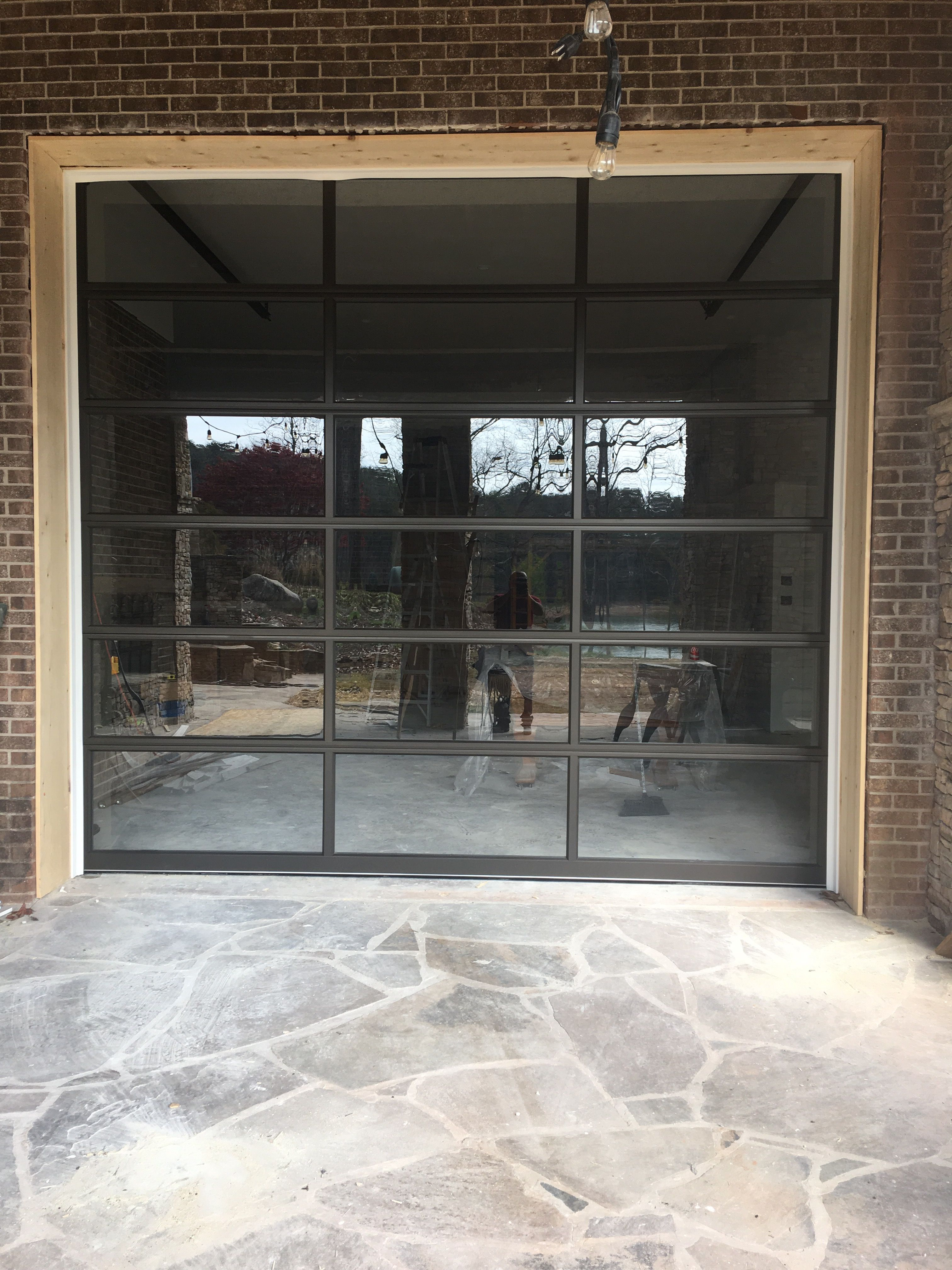 Full View Glass And Aluminum Garage Door Installed In A Basement
