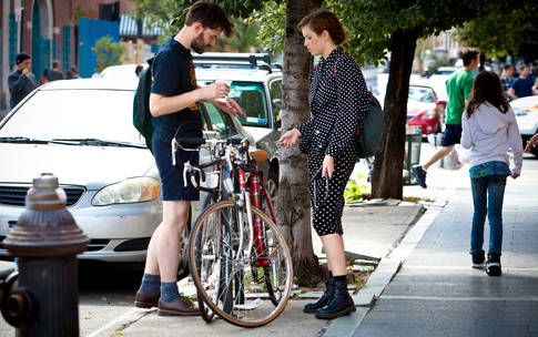 brooklyn hipsters locking bikes polka dotted outfit yp0026