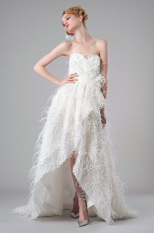 A combination of eyelet, feathers and a modern silhouette make this Elizabeth Fillmore gown a fresh, youthful choice.