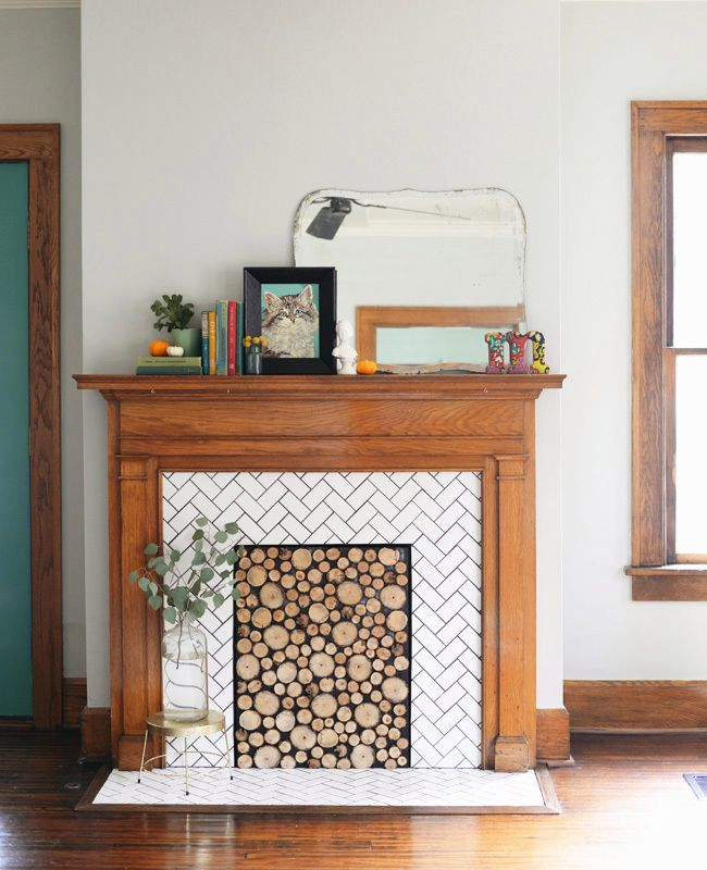 Keep Cozy With a DIY Log Cut Fireplace Filler