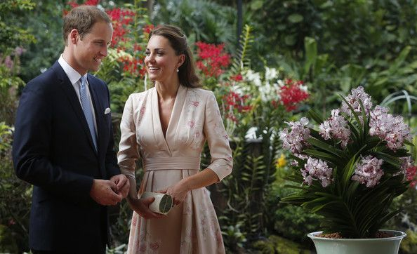 Kate Middleton Photos - Catherine, Duchess of Cambridge and Prince William, Duke of Cambridge smile as they look at an orchid named in honour of Diana, Princess of Wales at Singapore Botanical Gardens on day 1 of their Diamond Jubilee tour on September 11, 2012 in Singapore.  Prince William, Duke of Cambridge and Catherine, Duchess of Cambridge are on a Diamond Jubilee Tour of the Far East taking in Singapore, Malaysia, the Solomon Islands and the tiny Pacific Island of Tuvalu. - The Duke And Du