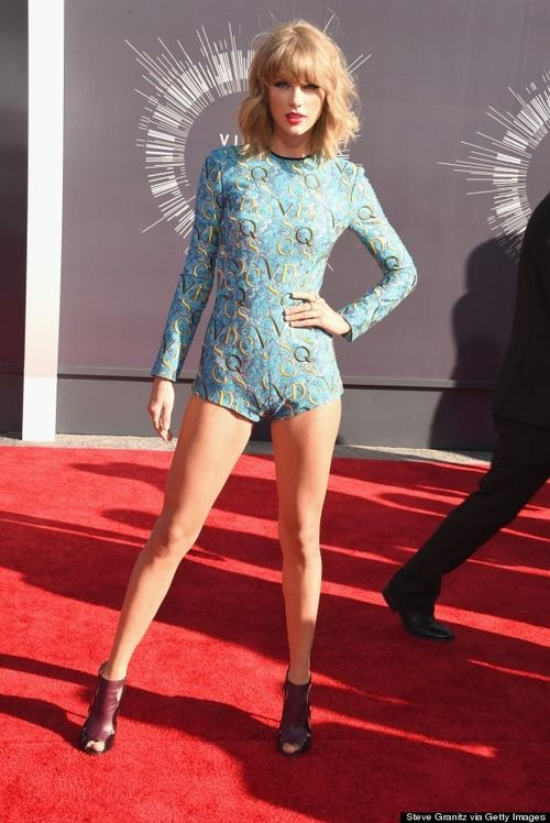 Fashion Flash: Taylor Swift has legs and she's not afraid to use them! Swift rocked a tiny blue lace romper by Mary Katrantzou, Elie Saab shoes, Lorraine Schwartz earrings and rings and gold pavhe bands by Ofira. What do you think? Does Taylor have a leg up on the competition?~Lisa J. Mitchell 8/25/14