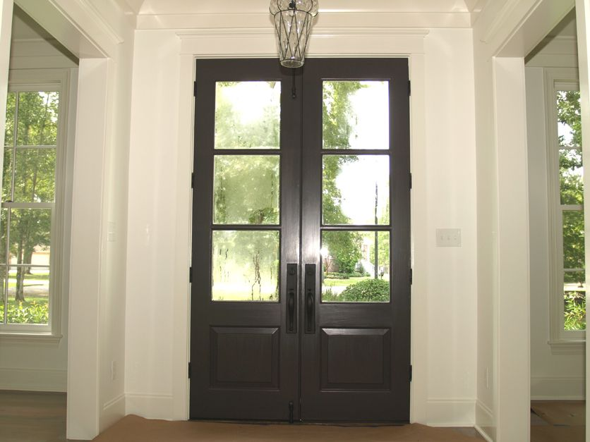 This 3 light spanish cedar front door has been stained a for Half glass exterior door
