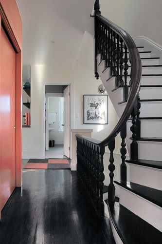 Peach Accent Wall love the contrast with black floor and white walls! Awesome combo!