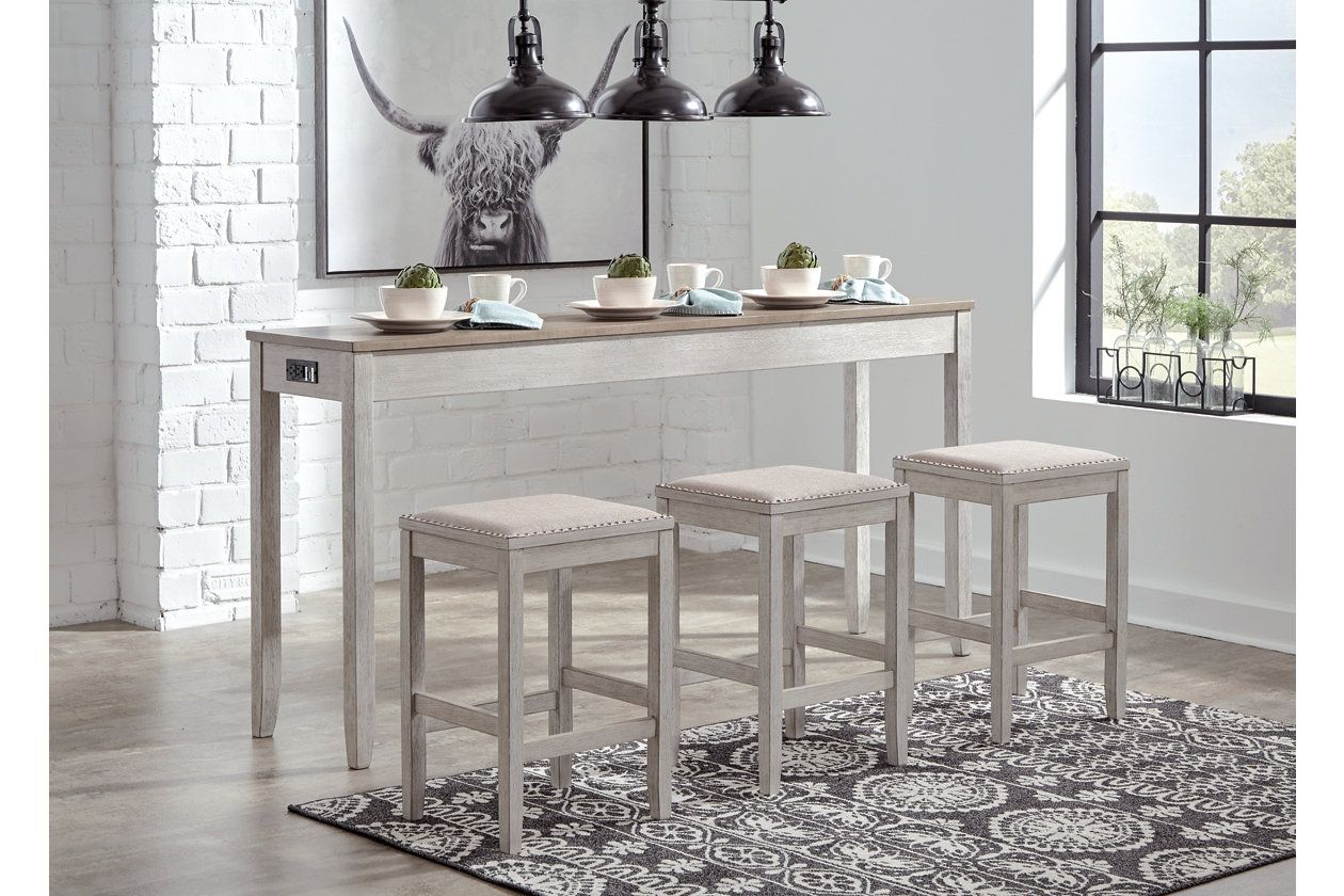 Skempton Counter Height Dining Table And Bar Stools Set Of 3 Ashley Furniture Homestore Counter Height Dining Table Counter Height Dining Room Tables Counter Height Dining Sets