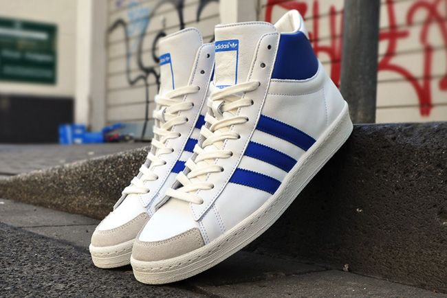 Dressed in classic leather digs and an original white and blue color  palette, adidas Originals has just dug the  AO Hook Shot II out its  archive.
