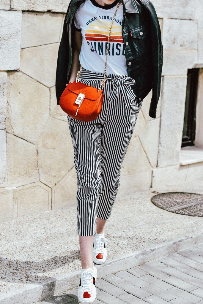 b85ac75c28278 Zara paperbag striped pants with tie bow in front, mango retro graphic tee,  asos printed tee, t-shirt, ace gucci sneakers, white leather sneakers, ...