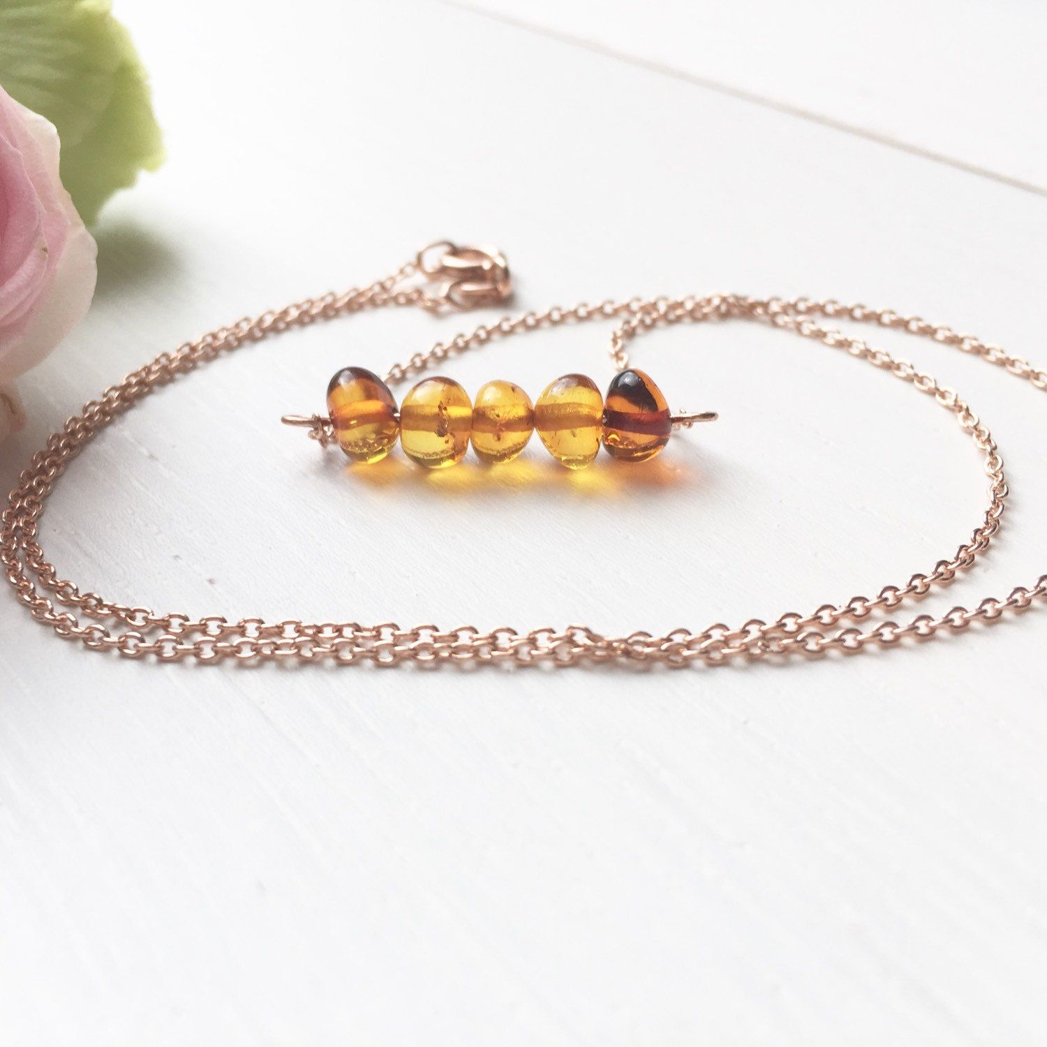 Baltic amber bar on a rose gold plated chain. A statement piece that is delicate & feminine.