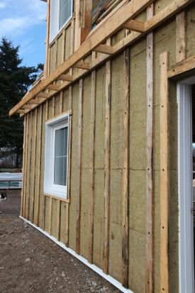 How To Attach A Thick Layer Of Exterior Insulation Exterior Insulation Wooden Buildings Exterior Siding