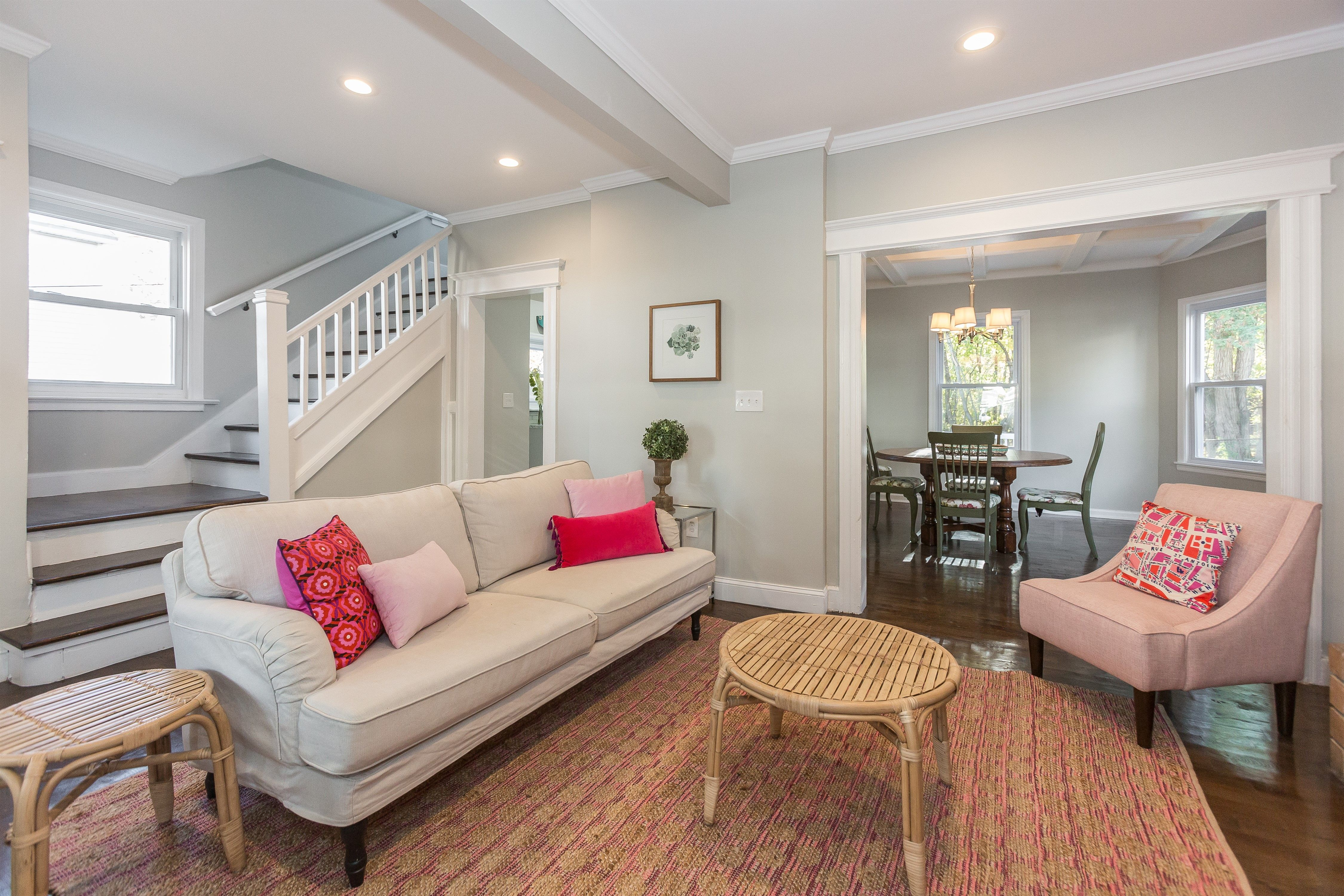 This living room features tasteful crown molding and an ...