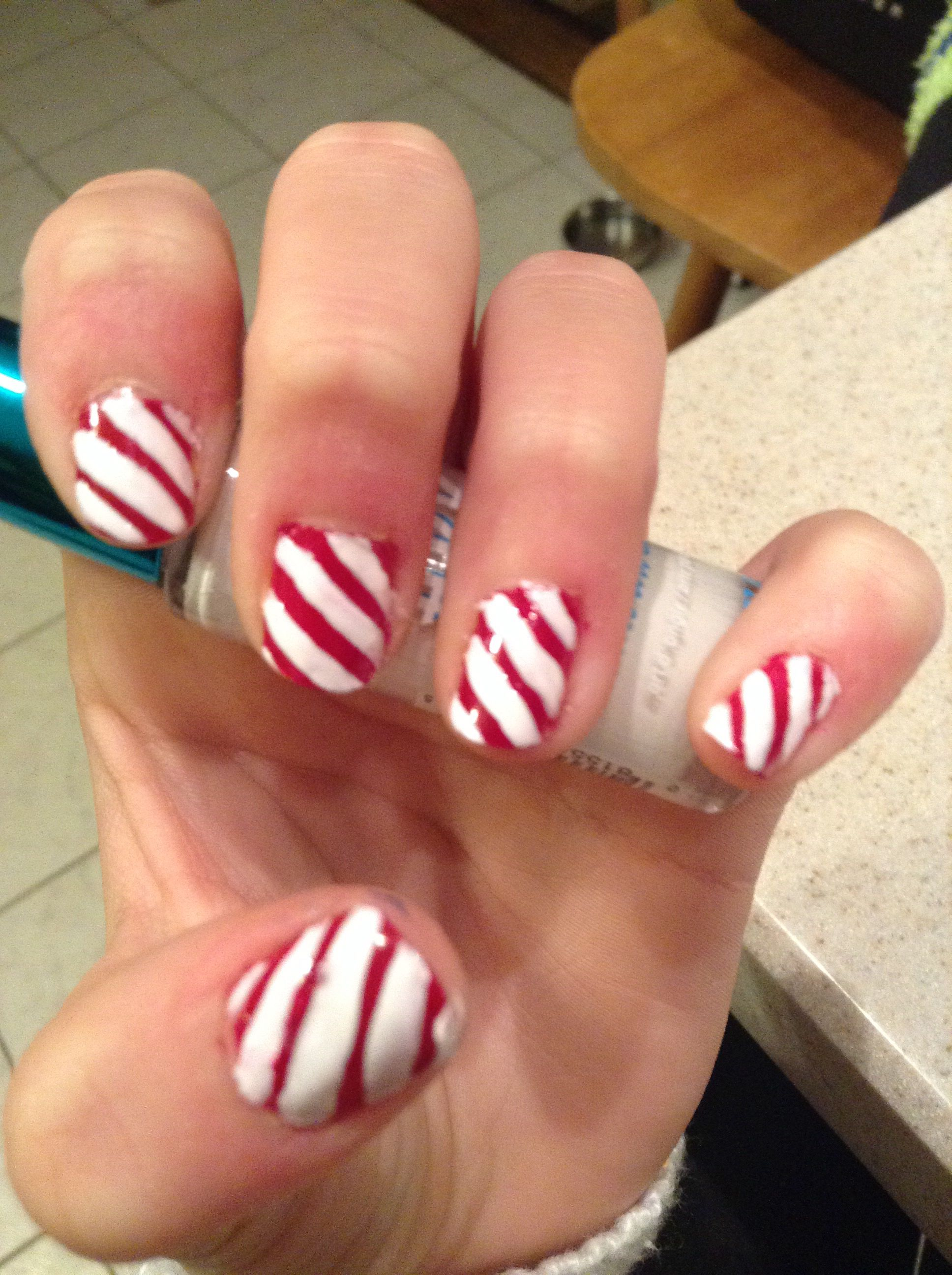 Candy cane nails are perfect for the holidays!