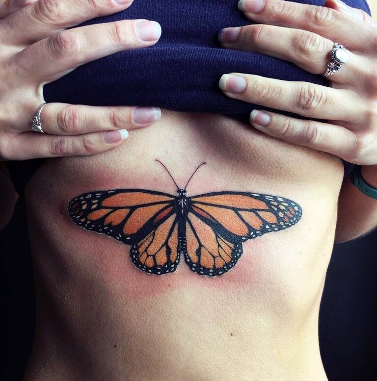 Amazing monarch butterfly sternum tattoo done by the for Electric lotus tattoo
