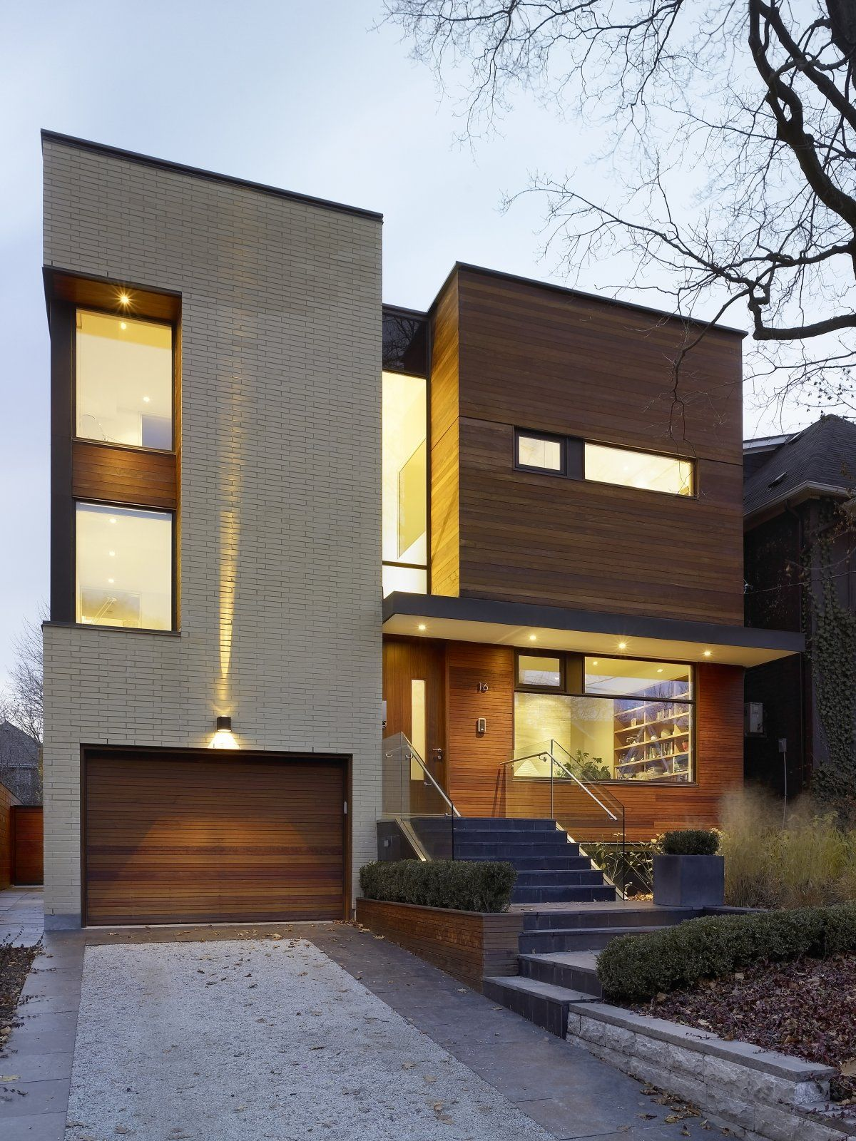 Contrast of light brick and warm timber, and metal framing to ...