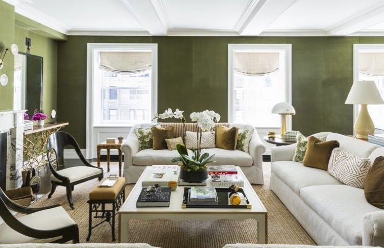 Living room with lacquered deep olive green walls and lots ...