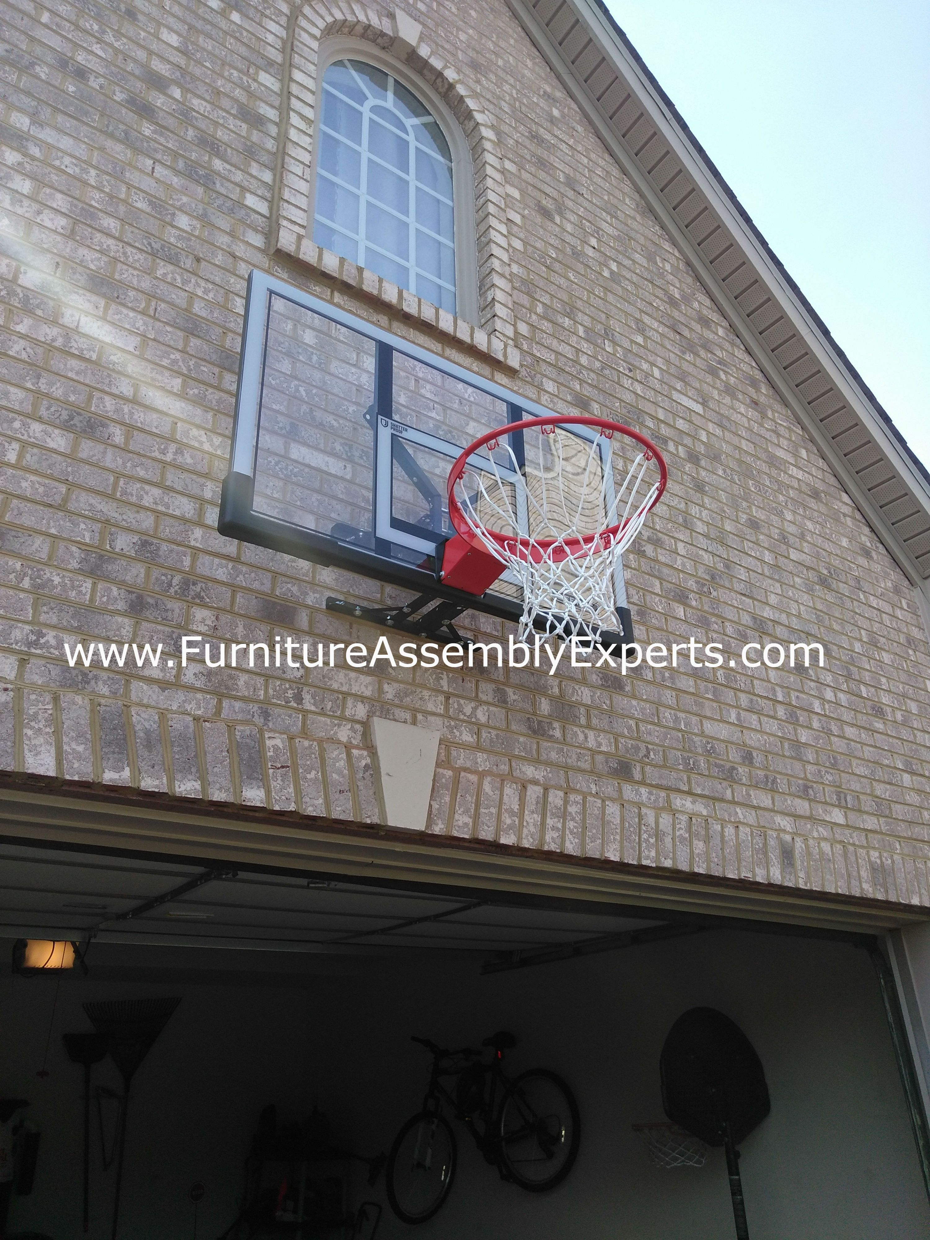basketball hoop wall installation by professionals completed for a