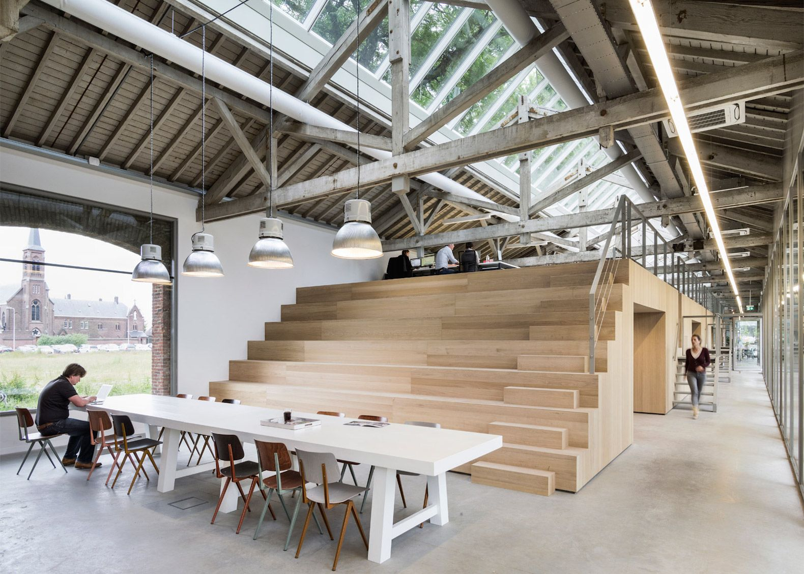 Old train shed is transformed into a gorgeous office and restaurant in the netherlands