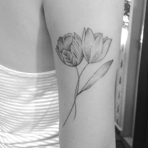 Black And White Intertwined Tulip Flowers Tattoo On Upper Arm Tattoos Picture