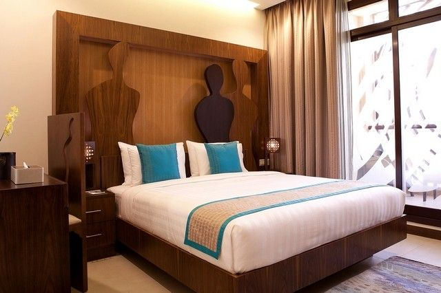 gorgeous art inspired decor with blue dark brown and beige with a hint of gold color scheme at the noon art boutique hotel apartments in dubai