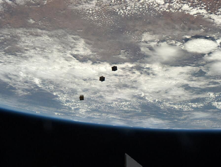 Three baby satellites leave their space station nest,   http://www.nbcnews.com/science/crowdfunded-nanosatellites-unleashed-orbit-2D11624550  Photo: NASA