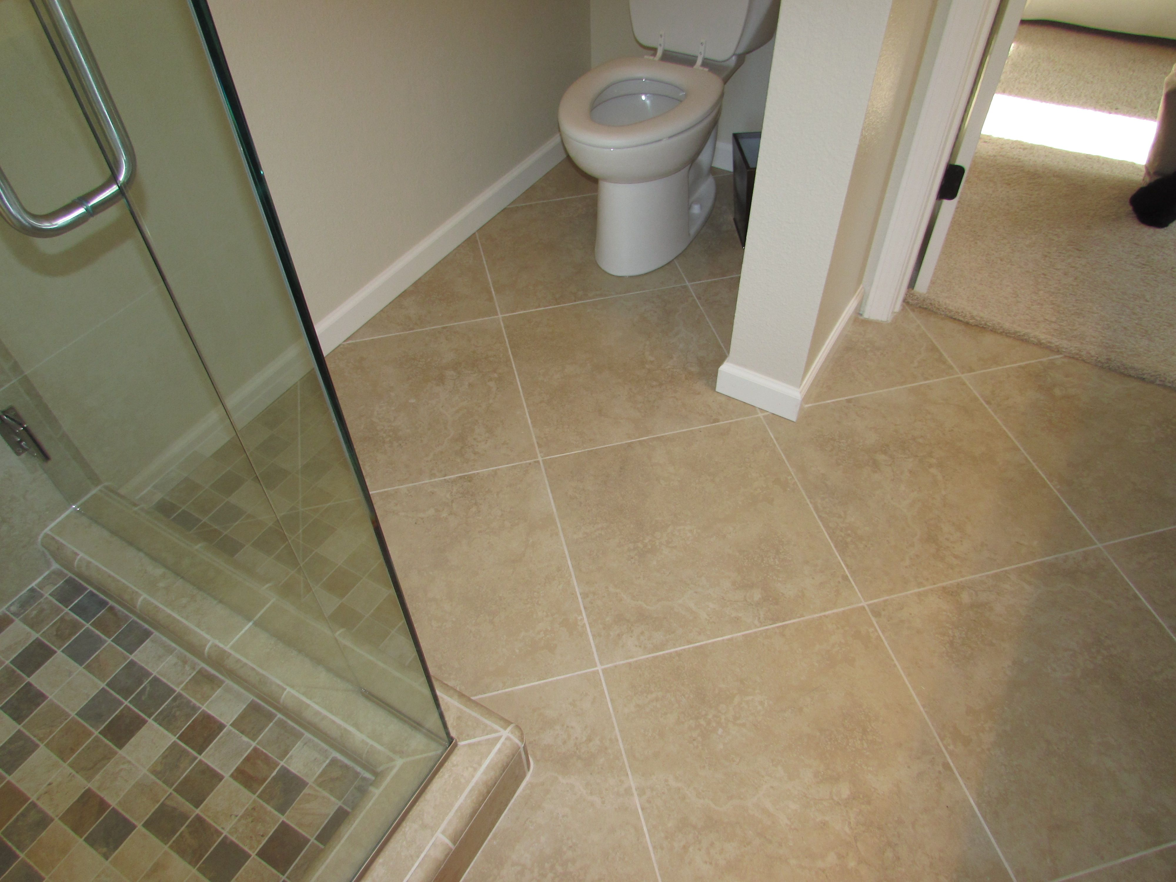 18 X 18 Rectified Porcelain Floor On A Diagonal Pattern On