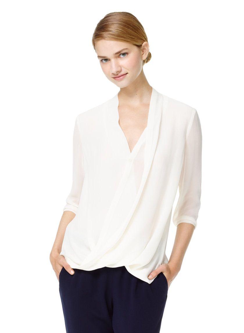 e1ae93a5c5e57 BABATON BEAU BLOUSE - A unique scissor-wrap blouse with a plunging V-neck