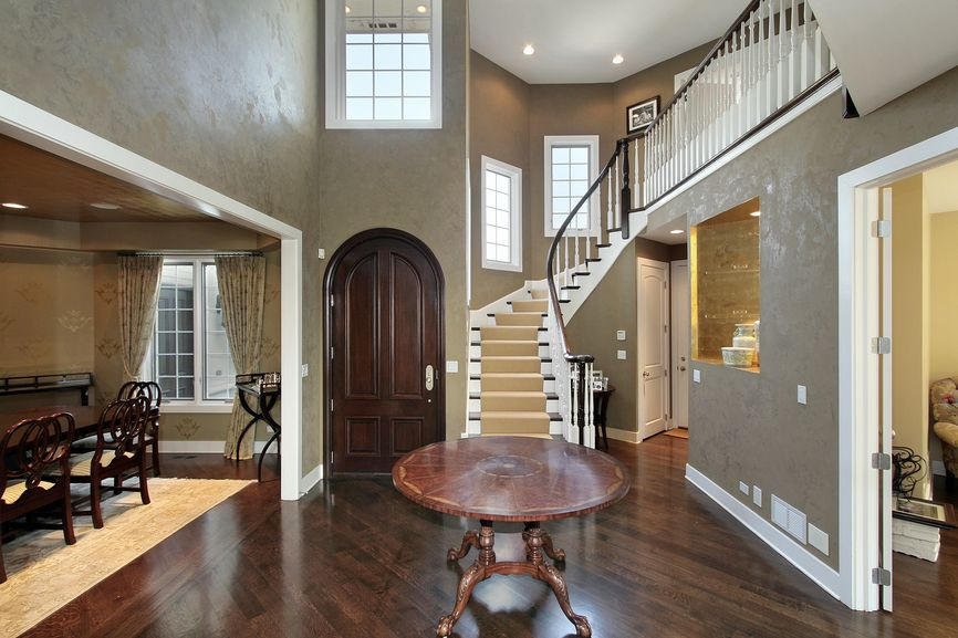 2 Story Foyer In New Home That Opens Up To A Formal Dining Room And Living