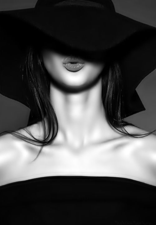 Portrait fashion photography black and white hat pose