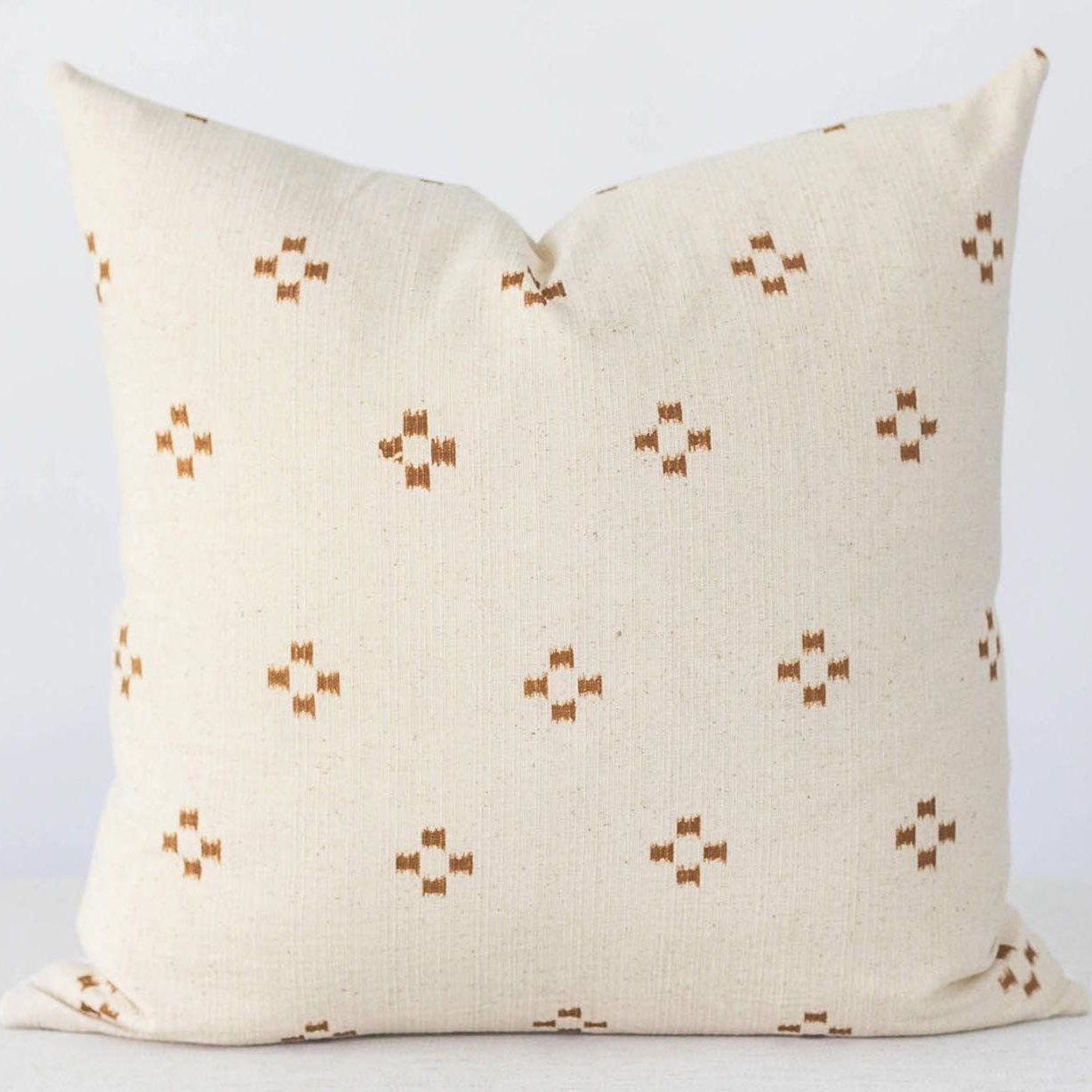 This boho inspired pillow cover is great all year round. The fabric is linen with a beautiful, soft texture. The front features a light cream with a dark orange/rust color for the pattern. Handmade in Texas!FEATURES✾ Cream colored fabric with rust pattern.✾ Pure white cotton canvas fabric on the back.✾ Zipper closure for easy removal. ✾ Made to order, ships in 5 to 7 business days. ✾ Insert NOT included. For best results we recommend spot cleaning and hand washing only.