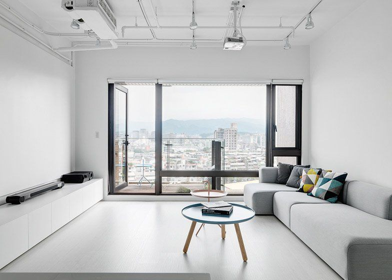 Clean, minimalist apartment with a window overlooking the city ...
