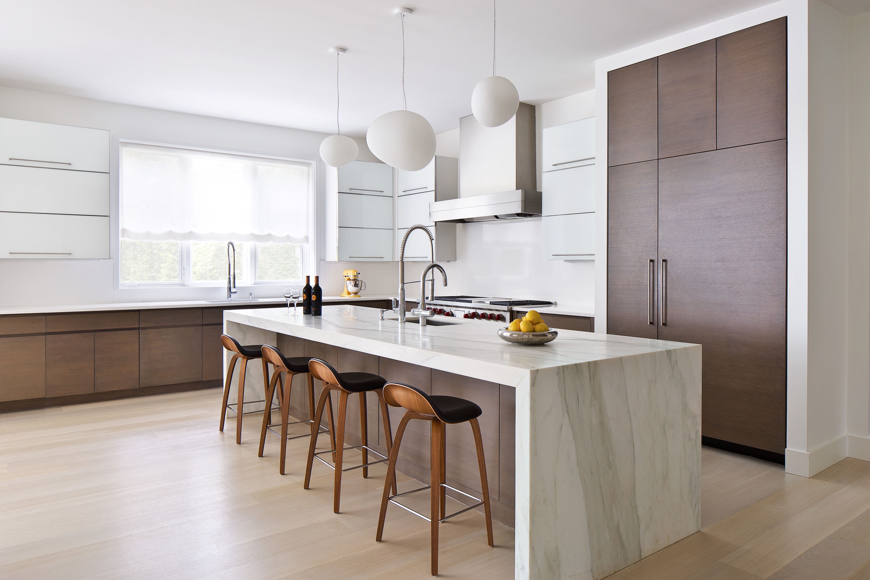 Modern kitchen with waterfall island countertop