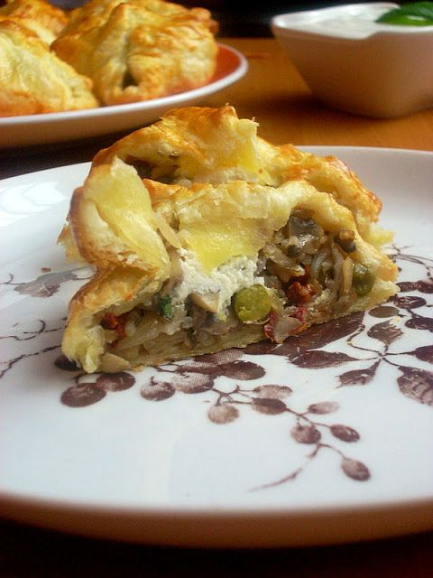 Puff pastry with rice, dried tomatoes, mushrooms, feta cheese and beans
