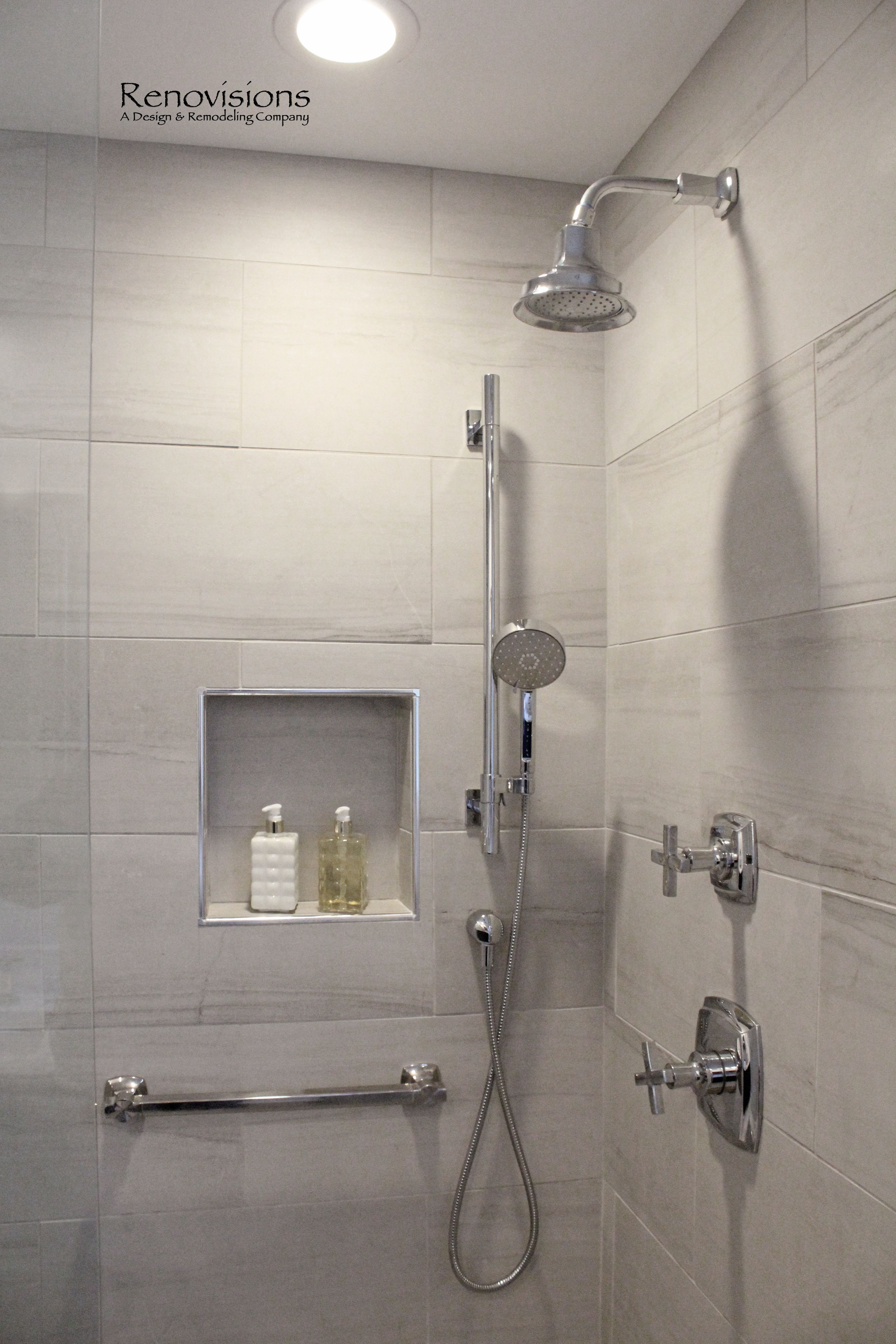 A pleted Master Bathroom remodel by Renovisions Walk in Shower