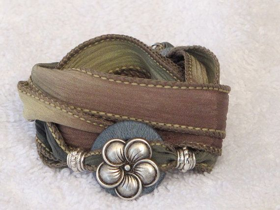 Silk Ribbon Whirly Wrap Bracelet in soft sand sage and teal with an antique silverfive petal flower button on Etsy, $36.00