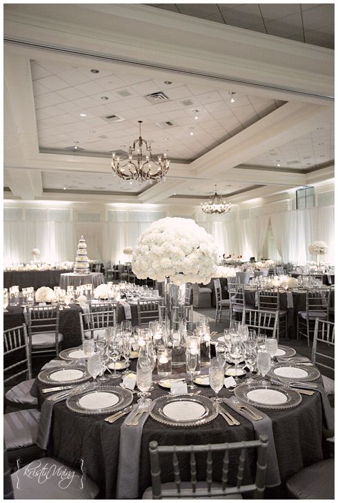 silver and white wedding reception, hurricane vase center pieces, custom linens, silver chiavari chairs, clear glass chargers, copyright @Kristin Vining Photography Charlotte, NC Wedding Photographer