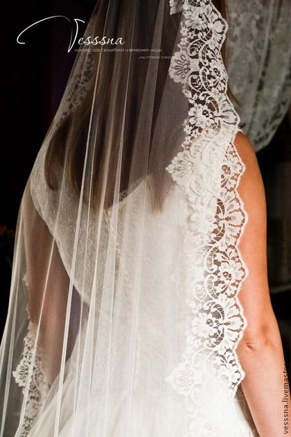 Photo of Handmade clothes and accessories. Veil with fr …
