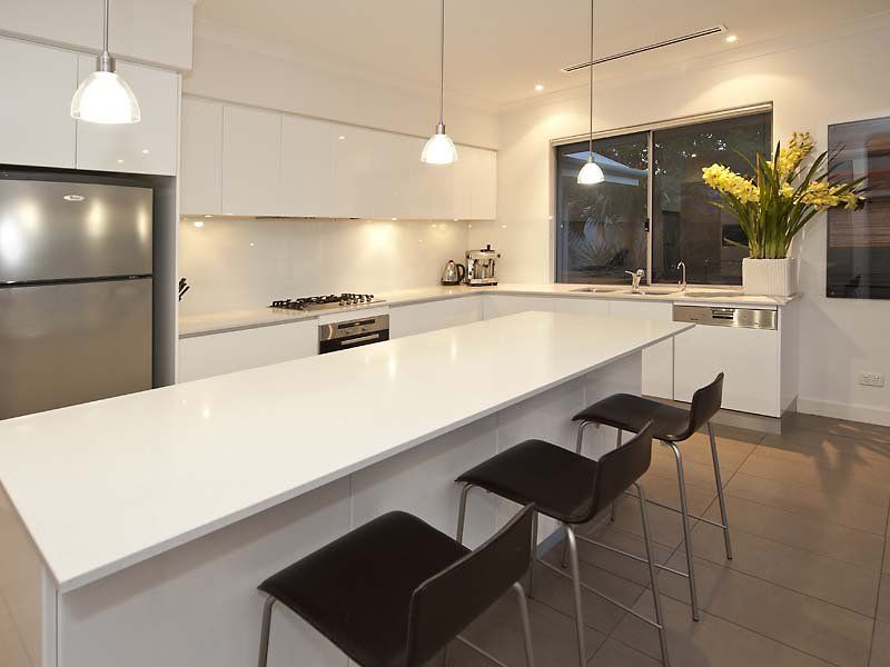 L Shaped Kitchen Design With White Modern Wall Cabinet Elegant Adequate  Lighting White Big Square Table Grey Stainless Steel And Black Modern Chair  Green ... Part 36