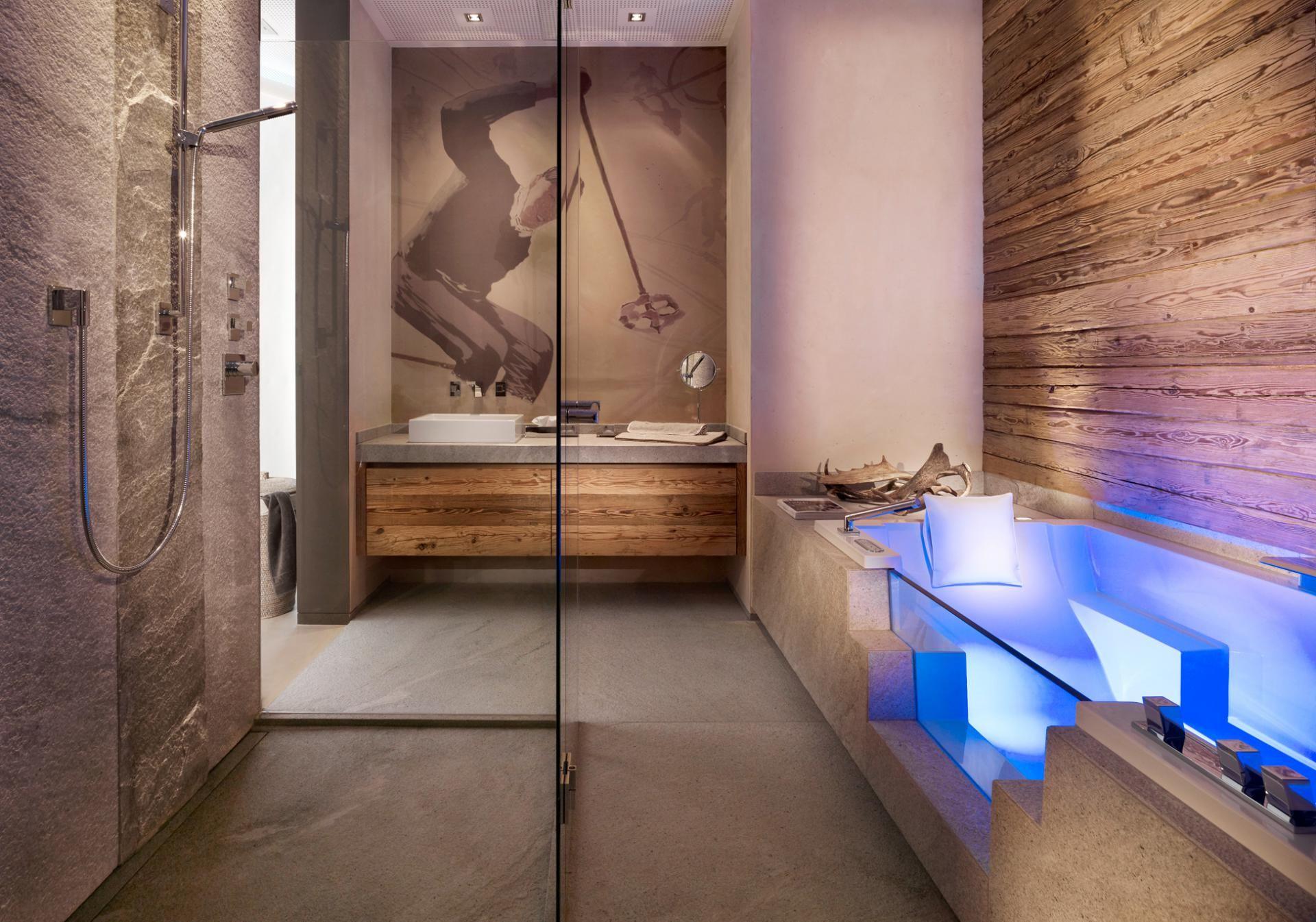 gasteiger bad architektur chaletstil mit patentierter terradistone wandspachtelung dornbracht. Black Bedroom Furniture Sets. Home Design Ideas