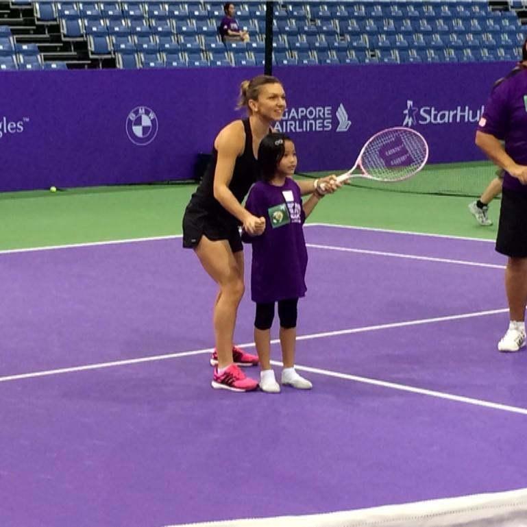 Simona Halep having fun during a WTAFinals kids clinic