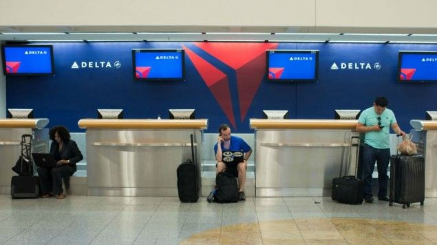 Passengers Wait At The Delta Ticket Counter At Hartsfield